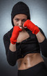 Hard sport woman ready for fight. Fighter girl with hoodie