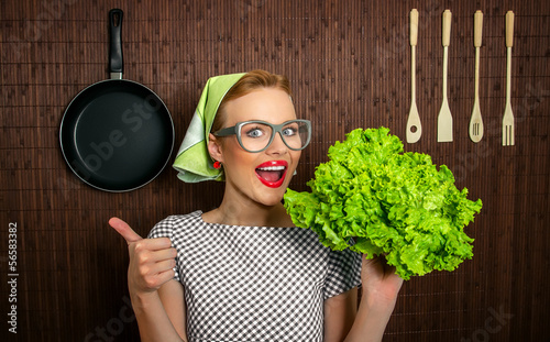 Happy woman cook with thumbs up holding salad
