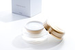 beauty cream container with box on white background