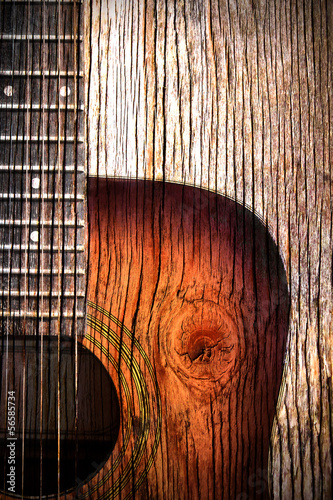 Acoustic guitar art on wooden background © totojang1977
