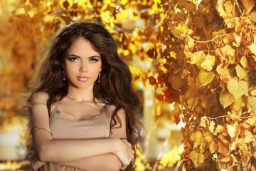 Beautiful girl with long hair enjoying the sunny in a autumn par