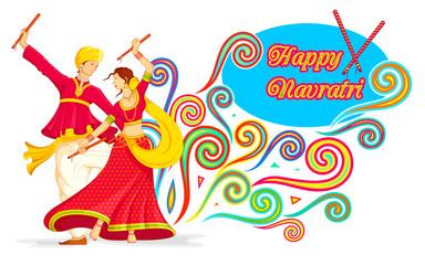 Couple playing Dandiya on Navratri