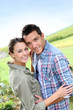 Portrait of sweet couple in countryside