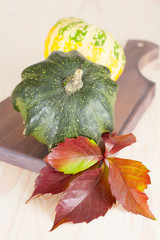 Autumn decoration with maple leaves and pumpkins