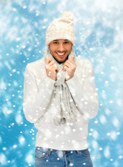 handsome man in warm sweater, hat and scarf