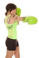 woman boxer green punch tattoos