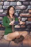 woman scarf green shirt phone rocks selfy poster