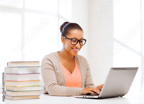 international student girl with laptop at school
