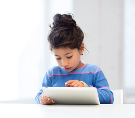 girl with tablet pc at home