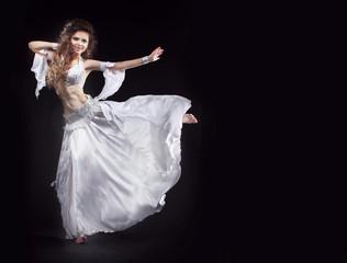 Beauty Girl belly dancer in white suit oriental dance in motion