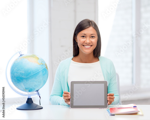teacher with globe and tablet pc at school