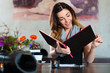 Woman in restaurant choosing food in menu