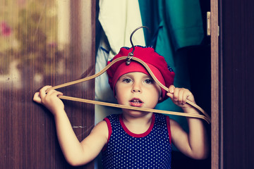 little girl in wardrobe
