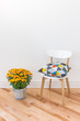 Orange chrysanthemums bright cushion on a chair