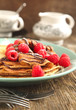 Crepes with fresh raspberry and powder sugar