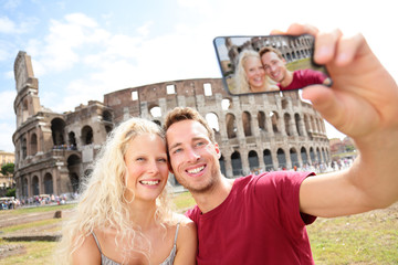 Tourist couple on travel in Rome by Coliseum