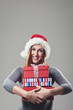 Smiling woman clutching a pile of Xmas gifts