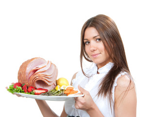 woman holding plate in hands with turkey meat ham decorated lett