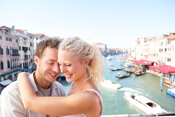 Dating couple hugging and kissing in Venice