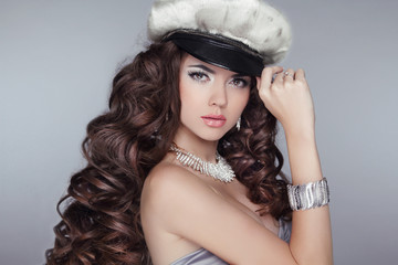 Glamour. Fashion girl  Model with long wavy healthy hair styling