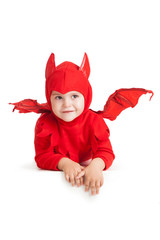 smiling little boy in red devil costume