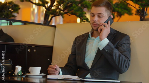 Young businessman does business over the phone