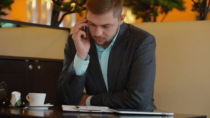 Businessman talking to someone on the phone