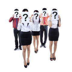 Business team hiding behind question mark symbol