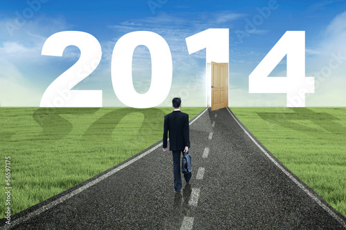 Businessman walks to the future in 2014