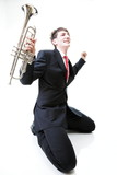 Excited man kneeling with trumpet in hand and screaming. Isolate