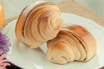 Two croissant on a plate