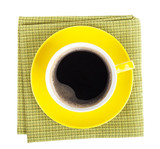 Yellow coffee cup over kitchen towel