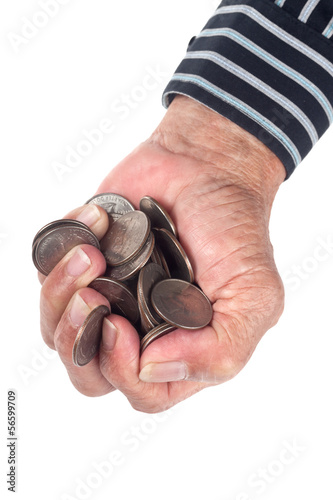 Elderly hand full of United States coins isolated on white