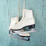 Ice skates on blue vintage wooden background - 56600579