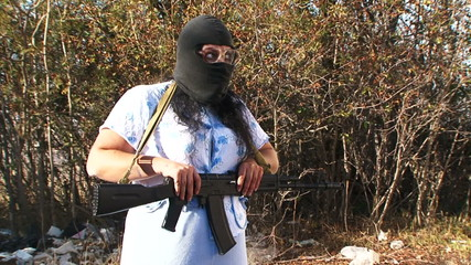 Mad woman equipped as a terrorist