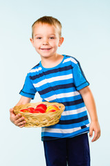 Boy and fruit basket