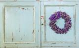 Lavender flower wreath hanging on an old door - 56601705