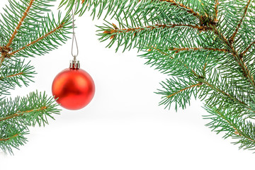 Pine branches with Christmas ornaments on white