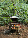 A Cooking Pot on a Tripod Over an Outdoor Wood Fire.