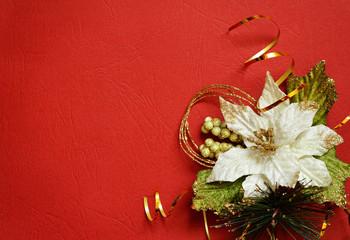 Red background with white pionsettia in a corner