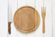 Empty cutting board on white planks food background concept