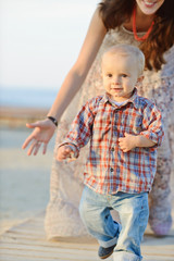 baby boy running from mother