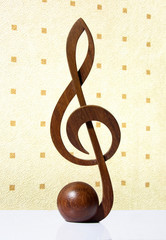 G-clef icon carved from wood
