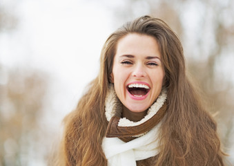 Portrait of happy young woman in winter outdoors