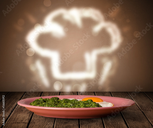Delicious food plate with chef cook hat