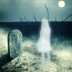 white transparent woman ghost on cemetery