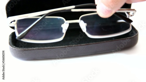 glasses in case on white background