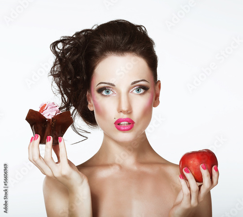 Dilemma. Diet. Undecided Woman with Apple and Cupcake
