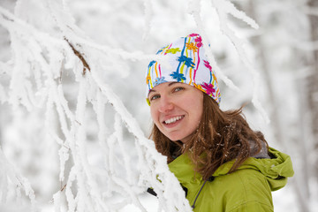 Young woman posing at camera in winter mountains