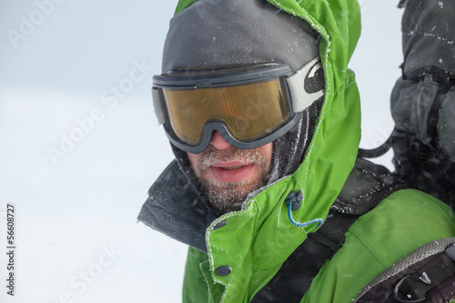Hiker covered with snow and ice closeup